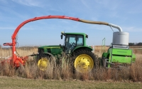 Harvesting native grasses on the GLBRC / KBS LTER biofuels research experiment with a plot combine that precisely measures yields; Photo Credit: J.E.Doll, Michigan State University