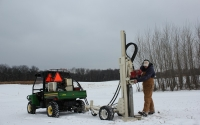 Field technician Kyle Corder collects deep soil core samples on the KBS LTER / GLBRC biofuels site in mid December; Photo Credit: J.E. Doll, Michigan State University