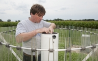 Information manager Sven Bohm checks a precipitation collector at the KBS LTER weather station; Photo Credit: K.Stepnitz, Michigan State University