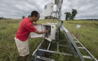 Research associate Michael Abraha checks the carbon dioxide eddy flux tower at one of the GLBRC / KBS LTER sites; Photo Credit: K.Stepnitz, Michigan State University