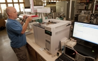 KBS LTER investigator Kevin Kahmark analyzes greenhouse gas samples in the lab; Photo Credit: K.Stepnitz, Michigan State University