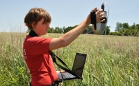 Undergraduate research intern Fraser Evans takes canopy spectorgraph readings in a GLBRC / KBS LTER switchgrass biofuel field near KBS; Photo Credit: KBS LTER, Michigan State University