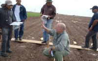 KBS LTER researcher Kevin Kahmark describes greenhouse gas sampling methods as part of a workshop in the Yaqui Valley of Mexico; Photo Credit: Ivan Ortiz-Monasterio