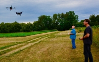 KBS LTER information manager Sven Bohm and Researcher Kevin Kahmark fly drones equipped with tools able to monitor crop health and ecosystems energy exchange as part of the Great Lakes Bioenergy Research Center (GLBRC) research on cellulosic biofuels. Photo Credit: Bill Krasean