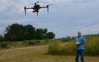 KBS LTER Researcher Kevin Kahmark fly drones equipped with tools able to monitor crop health and ecosystems energy exchange as part of the Great Lakes Bioenergy Research Center (GLBRC) research on cellulosic biofuels. Photo Credit: Bill Krasean