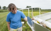 Site manager Stacey Vanderwulp checks instruments at a rainout shelter designed to simulate drought conditions on a small area of the KBS LTER Main Cropping System Experiment; Photo Credit: K.Stepnitz, Michigan State University
