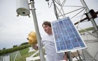 Information manager Sven Bohm checks KBS LTER weather station instruments; Photo Credit: K.Stepnitz, Michigan State University
