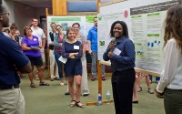 Research Experience for Undergraduates student Carlneshia Johnson presents her summer project at the 2016 KBS Undergraduate Research Symposium. Photo credit: Bonnie McGill, MSU