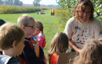 Elementary teacher Marcia Angle leads a student activity on the KBS LTER walking tour; Photo Credit: C. McMinn, Michigan State University