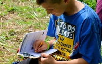 An elementary student works on an activity, part of the LTER Ag & Ecology Student Activity Trail. Photo credit: Sabrina Brown, MSU.