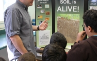 KBS LTER Science Coordinator Justin Kunkle expounds on soils at a research open house; Photo Credit: S.S.Cole, Michigan State University