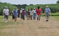 KBS LTER researcher Phil Robertson leads an International Agroecology Short Course group on a tour of the KBS LTER Main Cropping System Experiment; Photo Credit: B. Krasean, Michigan State University