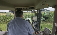 Agronomic manager Joe Simmons in a tractor on the KBS LTER/GLBRC biofuels experiment; Photo Credit: K. Stepnitz, Michigan State University