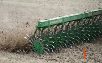A rotary hoe controls weeds in organic corn on the KBS LTER site ; Photo Credit: J.Simmons, Michigan State University