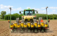 Planting corn in our low-input treatment on the KBS LTER Main Cropping System Experiment in May; Photo Credit: J.E. Doll, Michigan State University