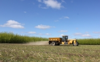 Applying lime (calcium carbonate) to the KBS LTER crop fields to adjust soil pH; ; Photo Credit: J.E.Doll, Michigan State University