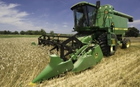 A combine harvests wheat on the KBS LTER in July; Photo Credit: K.Stepnitz, Michigan State University