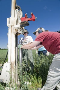 KBS researchers use a geoprobe to collect deep soil samples from the LTER plots.