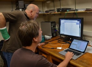 Kevin Kahmark and Sven Bohm work on one of the automated greenhouse gas chambers at the KBS LTER field experiment site in Michigan.