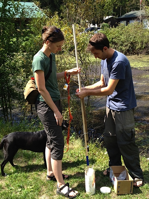 My labmate and good friend Dustin Kincaid (right) was doing an experimental draw-down of the Kellogg Forest pond last summer. Here, my dog, Bowie-wan Kenobi, and I are helping him install lysimeters, which allowed him to collect samples of the water within the pond muck at different depths. About 5 minutes after Steve Hamilton took this photo, Dustin and I were waist-deep in pond muck--so much fun!