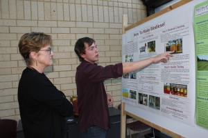 Alex Whitlow presenting his internship project at the KBS undergraduate research poster session in August. Photo courtesy of Julie Doll.