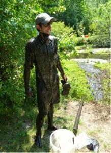 KBS LTER graduate student Dustin Kincaid emerging from a mud-filled wetland. Photo credit: Steve Hamilton.