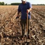 KBS LTER grad Brendan O'Neill samples soil on a Michigan farmer's field.