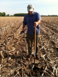 KBS LTER grad Brendan O'Neill samples soil on a Michigan farmer's field.