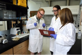 Dr. Jay Zarnetske, Joe Lee-Cullin, and Sydney Ruhala (from left to right) testing a MINIPOINT sampler in the lab. Photo Credit: http://zarnetskelab.weebly.com/people--facilities.html