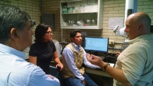 """""""Kevin Kahmark explaining the complexities of GHG analysis to a rapt audience in the COLPOS Gas Chromatography lab laboratory"""" Photo Credit: Neville Millar"""