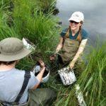 """Joe Lee-Cullin and I collecting flocculent material (floc) in Augusta Creek to test for carbon content."""